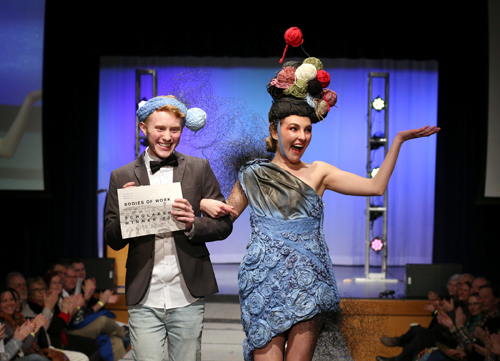 Andrew Bogard and Chloe Halverson walk the runway at Fashion Without Fabric after receiving the Scholarship Award for their design, worn by Halverson.