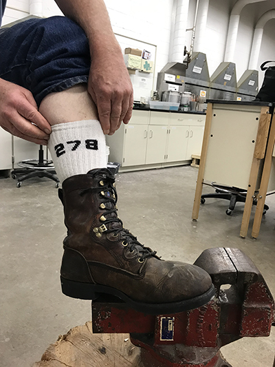 Arne Thompson, a retired veteran from northern Dunn County, wears 278th Brigade socks while working recently in a UW-Stout art lab.