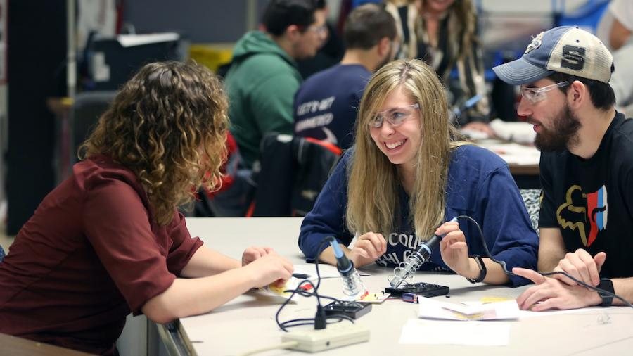 Technology education students learn to solder electronic circuit components in the tech ed lab in the Communication Technologies building.