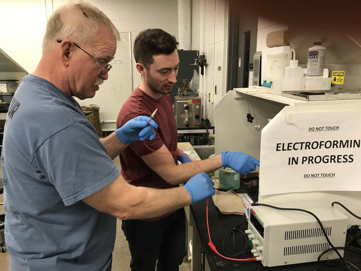 Arne Thompson, left, works on electroforming in a lab with Assistant Professor Vincent Pontillo-Verrastro.