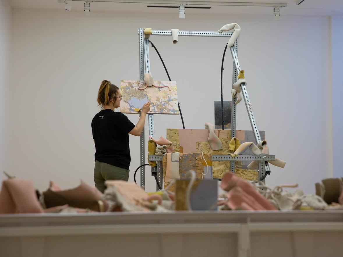 Emily Gordon, a Student Artist-in-Residence, prepares her exhibit at Furlong Gallery.