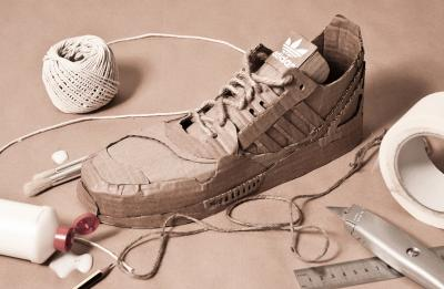 Sneaker prototype made from cardboard and laced with twine.